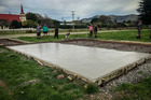 Porangahau locals pitched in to build a new fenced concrete pad for the rescue helicopter. Photo / Paul Taylor