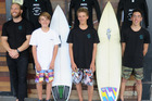Johnny Andrews presents Karn Godfrey, Ben Moretti and Taj Brougthon with new wetsuits and apparel earlier this month to help them stay out in the water long this winter.
