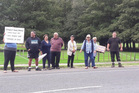People demonstrate outside Craggy Range on Saturday. Photo / Ruby Harfield