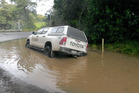 This Conservation Department vehicle is stuck in flooding caused by lack of road maintenance, farmer Winston Oliver says. Photo / Supplied