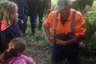 Edwin Smith, co-ordinator of the Tānekaha Community Pest Control Area releases Hugh the kiwi into his burrow.