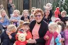 Margaret de Vries with children at the Waikanae Montessori Preschool Teddy Bears' Picnic.