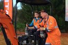 Ivanca Jedd, 11, learning the controls to the digger.