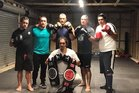 Fight Nite trainer Jason Reti (standing, centre) with his pugilists - Chase Herbert, Sean Herbert, Rob Leef, Carlos Waikai and in front Rawiri Bishop.