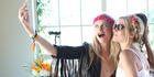 Model Poppy Delevingne (R) and Jackie Swerz attend a brunch in Palm Springs, California. Photo / Getty