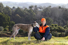 Reiss Jenkinson and his greyhound named Gracie at the site where Jenkinson plans to build a house and a family. Photo/John Borren