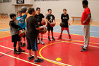 Stars of the future? Whanganui basketball players gather around in-form Manawatū Jet Daishon Knight. Photo / Stuart Munro