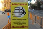 Anti-Tourist Action: Posters tell tourists to jump off their balconies. Photo / twitter, @barricidi
