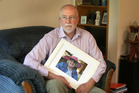 Robert Love holds a picture of his late mother who suffered from failings during her care in St Kilda Care Home, Cambridge, last year. More failings have since been discovered. Photo / File