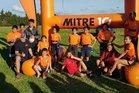 Matauri Bay Primary Schools Rippa Rugby players (in orange T shirts) from left Damian Flavell (standing up), Houkura Lunjevich, Tayiah Takaia, Aaliyah Tavita, Quest Tango, Te Mana Nordstrom, Manaakitia Rapata, Tereina Timoti-Hohaia and Moana Rush, absent: Kelly Rule.