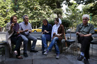 Iranians enjoy ice cream in northern Tehran. The price of milk has doubled in the space of a week. Photo / AP