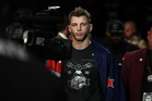 Dan Hooker will make his next walk into the octagon at UFC Fight Night Milwaukee in December. Photo / Getty Images