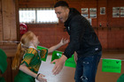 All Blacks star Sonny Bill Williams mixing it with the Drury Rugby Club juniors at the club in South Auckland. Photo / Brett Phibbs