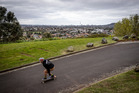Skateboarder Stephen Davis takes a ride down the access road to Mt Roskill.  Photo / Dean Purcell