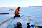Glaciologist Keith Nicholls, from the British Antarctic Survey, at work on Greenland's Petermann Glacier whose ice shelf has lost 23 miles of its length, reaching a record low size. Photo / Getty