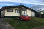 The house in Hamilton, where a family was terrorised by a gunman looking for a man who lived next door. Photo / File