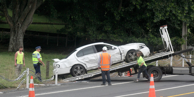 Waipa Towing pulls the crashed Falcon XR8 out of the paddock on Ohaupo Rd.