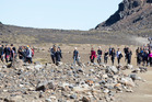 Walkers in the southern crater of the Tongariro Crossing, on a fine day.