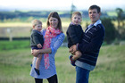 Nadine Tomlinson, pictured with husband Scott Tomlinson and sons Angus, right, and Sam, left. Nadine and Angus were killed in a tractor incident on their farm. Photo / Supplied