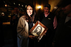 New Zealand Prime Minister Jacinda Ardern holds a drawing given to her by Hobbiton artist Will Bechnan during a tour of Hobbiton. Photo / Getty