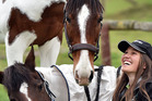 Talia Allison, of Dunedin, with horse Mustang Shelby (standing) and Mustang Puzzle Me. Photo / Peter McIntosh