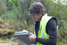 Horizons Regional Council senior water quality scientist Logan Brown was recording information about the Rangitīkei in this 2012 photo. Photo / Laurel Stowell