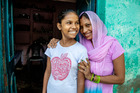Thanks to World Vision 14-year-old Kiran (left) now goes to school fulltime in Agra - and her mother Mumta couldn't be happier with her daughter's dream of becoming a doctor. Photo / Mike Scott