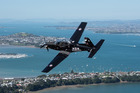 A Beechcraft T-6C Texan II pictured above Auckland. File photo / RNZAF