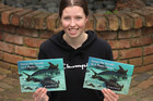Kerikeri teen Alex Edwards with her newly published bilingual book, Ārewa te Araara i te Moana Parahitiki / Trevor the Trevally in a Plastic Ocean. Photo / Peter de Graaf