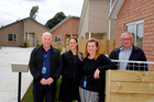 Nick Seymour (left), Renee Regal, Denise Simon and Dennis Cook of HNZ celebrate the completion of new houses at Poynter Place. Photo / Bevan Conley