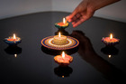 Diya, traditional clay oil lamps, are a central part of Diwali. Photo / Jason Oxenham