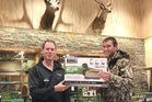 Alan Betschart from Te Awamutu (right), wearing his new jacket, receives a decoy pack from Scott Fraser at Waikato Hunting & Fishing. Photo / Supplied