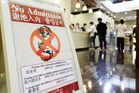 A sign in a bathhouse in Osaka, Japan says customers with tattoos are not allowed to enter. Photo / Japan News-Yomiuri