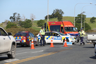 Police at the scene of a double fatal accident on SH1 south of Whangārei on Saturday.