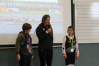 Paraparaumu Beach School students Liam Thomas, left, and Alyra Curtis-Capes, right, with Olympic rower Rebecca Scown.