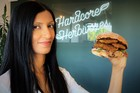 Sunfed Foods co-founder Shama Lee poses with a burger featuring Chicken-Free Chicken. Photo / Supplied.
