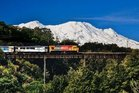 Ruapehu towers in the background as the Northern Explorer crosses a viaduct through Tongariro National Park. Photo / KiwiRail