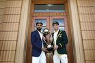 Virat Kohli of India and Tim Paine of Australia pose with the Borderâ€