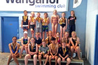 The Toyota Whanganui Swim Team are weighted down with medals won at the Taranaki Junior Championships in Stratford.