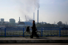 Smokes billows from the chimneys of Pyongyang Power Plant in Pyongyang, North Korea. Photo / AP