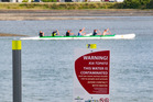 Waka ama paddlers braved the polluted waters but swimmers in the IronMaori event were kept out. Photo / Warren Buckland