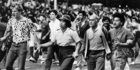 The historic Herald photo of Māori warden the late Hine Grindlay and others trying to bring peace to the 1984 Queen St riot in Auckland. Photo / File
