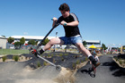Lochlan Watson, 14, pulls a scooter trick on the senior track at the official opening of the Whanganui Community Bike Park on Saturday.