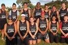 Lil Caps won the Top Field Touch Module social division on Tuesday night. From left are, Nikau Marsden, Ihaia Te Wara, Eli, Steve Marsden (team trainer), Maani Marsden, Eliza Marsden, Taupaki Marsden (team trainer), Hinerangi Waikai (manager), Rowie Tatana, Shayla Wallace, Carlos Waikai (coach), True Waikai (captain) and Caolan Price. Photo / supplied