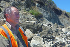 George Matthews says moving protective rocks at Kai Iwi Beach was a bad mistake. Tuesday, December 18, 2018 Whanganui Chronicle photograph by Laurel Stowell.