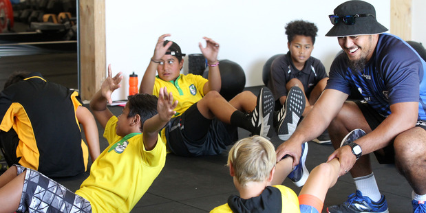 Timo Vaiusu, teacher, Kimi Ora Community School, helps pupils on the first day of the Flaxmere Schools' Sports Academy at the Hawke's Bay Community Fitness Centre Trust in Hastings. Photo/Duncan Brown