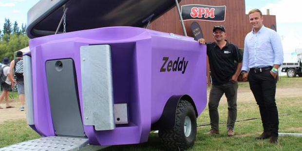 Zeddy team members Shane Parlato and Pearse McGoughan show off the Zeddy 1250 Dry Feeder, which won the Southern Rural Life Innovation Award at the Southern Field Days recently. Photo: Nicole Sharp
