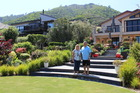 Kevin and Morag Woodley in their garden which is part of the Waikanae Lions Super Garden Trail. Photo / Rosalie Willis