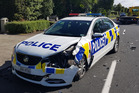A damaged police car after it was involved in a collision with another car in Stonefields. Photo / Sam Sword