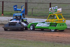 Luke Miers, left, and Damon Baxter in a great two car battle, just like will be seen in the Stockcar Shootout on Sunday night. Photos / Supplied